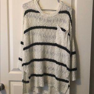 Vestique black and white sweater.